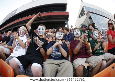 CONCORD, NC - MAY 29, 2011:  NASCAR fans show their support for their favorite team during the Coca-Cola 600 race at the Charlotte Motor Speedway in Concord, NC. - stock photo