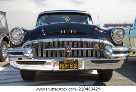 CONCORD, NC -- SEPTEMBER 20, 2014:  A 1955 Buick automobile on display at the Charlotte AutoFair classic car show held at Charlotte Motor Speedway. - stock photo