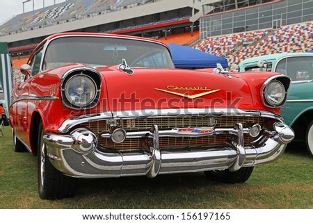 CONCORD, NC - SEPTEMBER 21:  A 1957 Chevy Bel Air on display at the Charlotte Auto Fair classic car show at Charlotte Motor Speedway in Concord, North Carolina, September 21, 2013. - stock photo