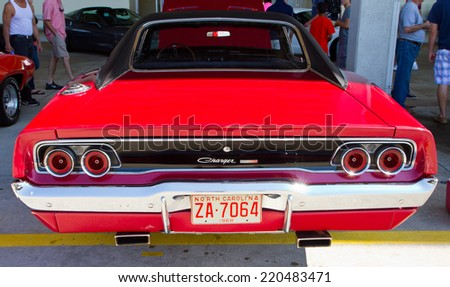CONCORD, NC -- SEPTEMBER 20, 2014:  A 1968 Dodge Charger automobile on display at the Charlotte AutoFair classic car show held at Charlotte Motor Speedway. - stock photo