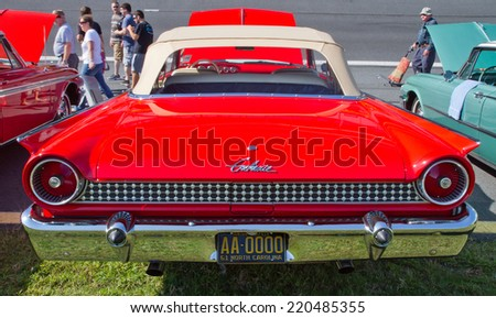 CONCORD, NC -- SEPTEMBER 20, 2014:  A 1961 Ford Galaxie automobile on display at the Charlotte AutoFair classic car show held at Charlotte Motor Speedway. - stock photo