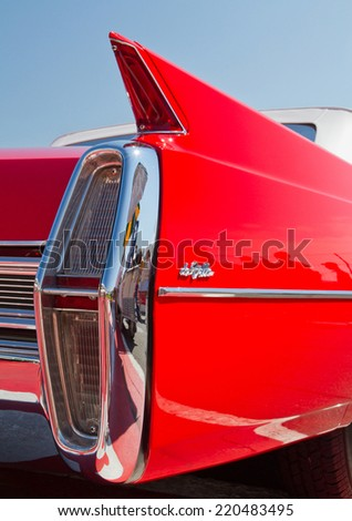 CONCORD, NC -- SEPTEMBER 20, 2014:  Closeup of tail fin on a 1964 Cadillac automobile on display at the Charlotte AutoFair classic car show held at Charlotte Motor Speedway. - stock photo