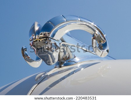 CONCORD, NC -- SEPTEMBER 20, 2014:  Hood ornament of a 1951 Dodge automobile on display at the Charlotte AutoFair classic car show held at Charlotte Motor Speedway. - stock photo