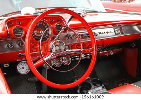CONCORD, NC - SEPTEMBER 21:  Interior of a 1957 Chevy Bel Air on display at the Charlotte Auto Fair classic car show at Charlotte Motor Speedway in Concord, North Carolina, September 21, 2013. - stock photo