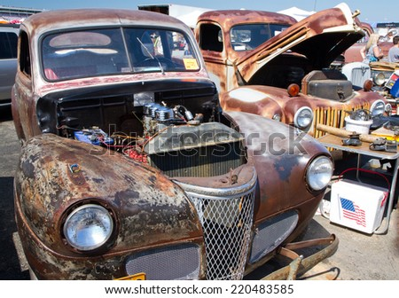 CONCORD, NC -- SEPTEMBER 20, 2014:  Unrestored Ford vehicles on display at the Charlotte AutoFair classic car show held at Charlotte Motor Speedway. - stock photo
