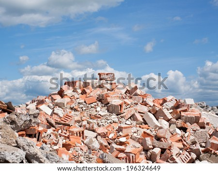 Concrete and brick rubble debris on construction site - stock photo