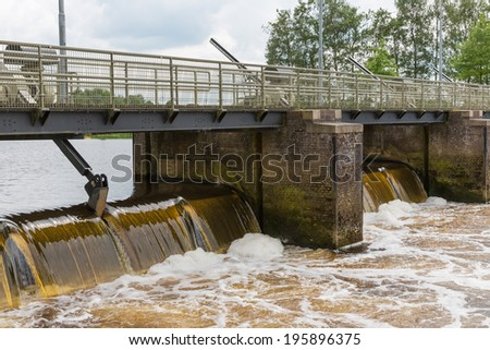 Concrete barrage in Dutch river Vecht - stock photo