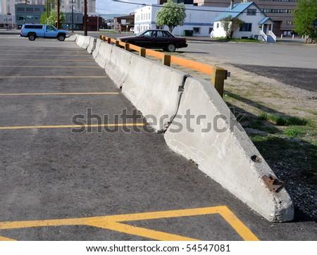 Concrete Barrier between parking lots - stock photo