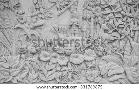 Concrete bas in traditional style on wall of fence, Thailand - stock photo