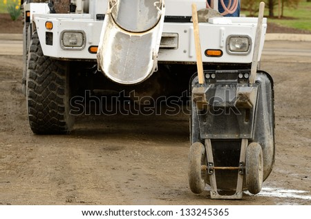 Concrete being placed into a wheel barrow to be tested at a large commercial housing development in Oregon - stock photo