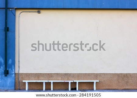 concrete bench in sport stadium and abstract grunge wall. Copyspace for your text. For presentation. - stock photo