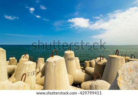 concrete block break water at baltic sea - stock photo