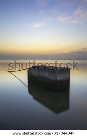 Concrete block in Tagus River, at dawn