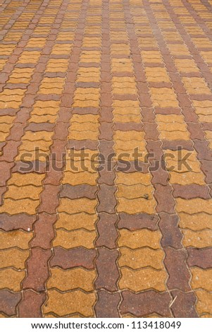 Concrete block paving, paving a row. - stock photo