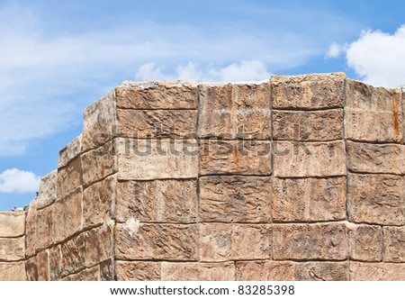 Concrete block wall with blue sky. - stock photo