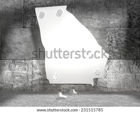 concrete blocks empty room with clear outline georgia state map attached to wall by bolts - stock photo