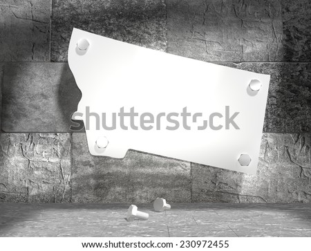 concrete blocks empty room with clear outline montana state map attached to wall by bolts - stock photo