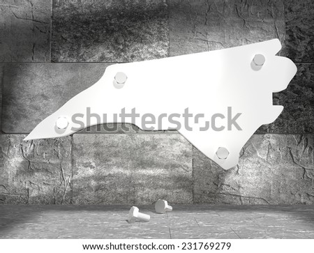 concrete blocks empty room with clear outline north carolina state map attached to wall by bolts - stock photo