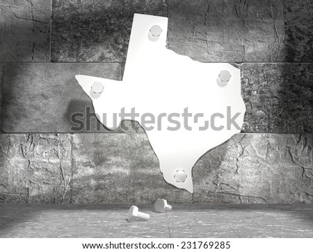 concrete blocks empty room with clear outline texas state map attached to wall by bolts - stock photo