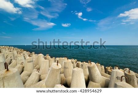 concrete breakwater by the Baltic sea - stock photo