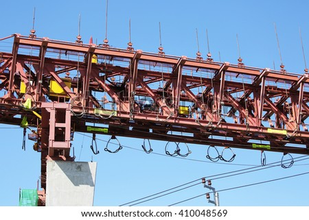 Concrete bridge across Chaophraya river under-construction of its foundation and road surface supporting structure. - stock photo