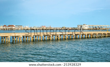 Concrete bridge fishing boat - stock photo