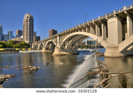 concrete bridge spanning the Mississippi River near St Anthony Falls - stock photo