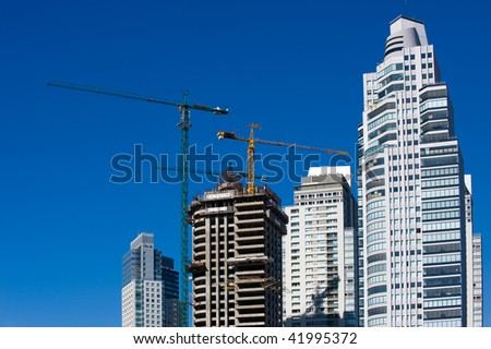 Concrete Building Construction with Cranes - stock photo