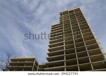 Concrete building structure, unfinished and abandoned - stock photo