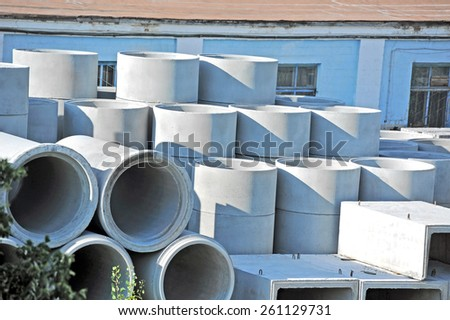Concrete circle pit and pipe block on factory yard - stock photo