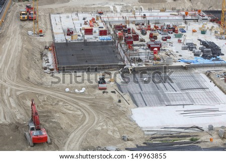 concrete construction with digger, trucks and bulldozer - stock photo
