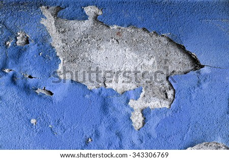 Concrete cracked blue wall as a grunge background - stock photo