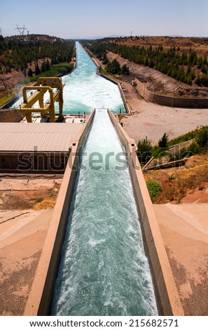 concrete dam and the water is drained from the spray  - stock photo