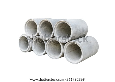 Concrete drainage pipes stacked for construction, irrigation, industry isolated on white background - stock photo