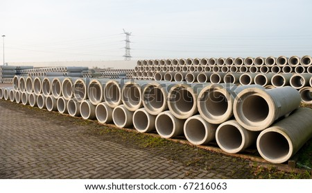 concrete drainage pipes stacked on a construction site