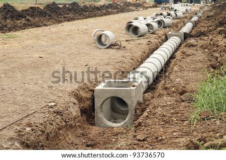 Concrete drainage tank on construction site - stock photo