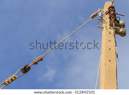 concrete electric pole and sling in blue sky day