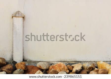 Concrete fence decorate by large stone in vintage tone. - stock photo
