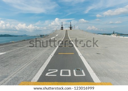 Concrete fighter jet run way of an aircraft carrier, taken on a sunny day in Thailand