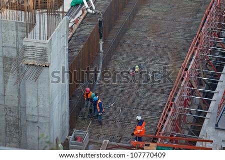 Concrete filling into the formwork - stock photo