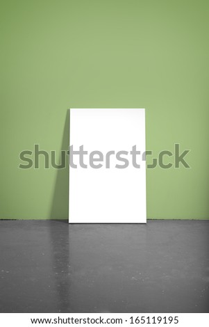 concrete floor and green wall with poster - stock photo