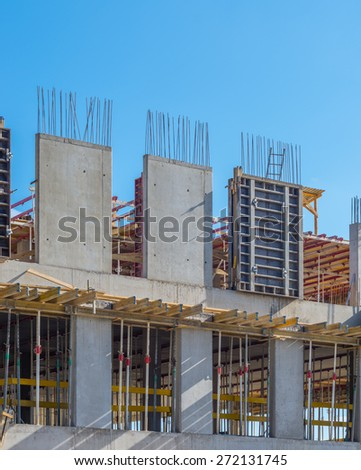 Concrete formwork and reinforcing bars on the office building construction site - stock photo