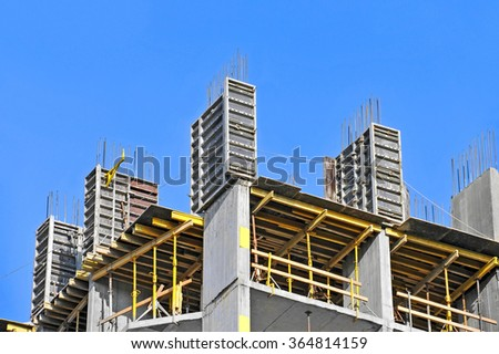 Concrete formwork with a folding mechanism and floor beams on construction site - stock photo