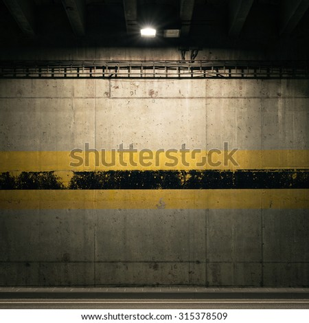Concrete garage wall with spotlight - stock photo