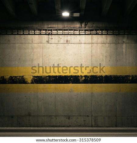 Concrete garage wall with spotlight - stock photo
