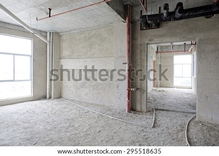 Concrete interior of unfinished apartment   - stock photo