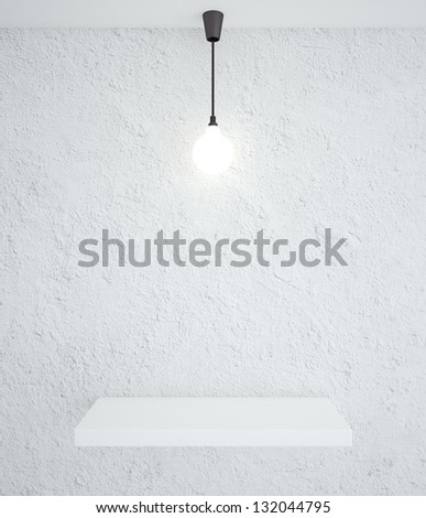 concrete interior with podium and lamp - stock photo
