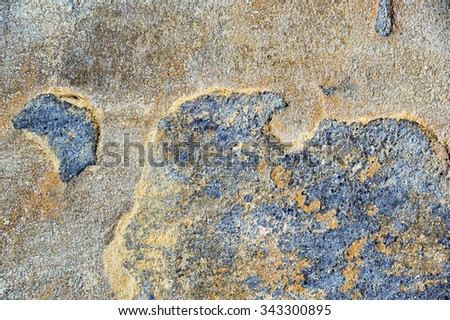 Concrete multicolored cracked wall as a grunge background
