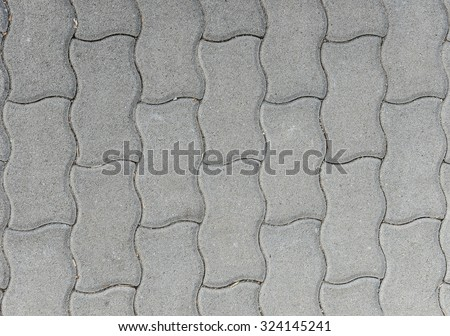 Concrete or cobble gray pavement slabs or stones  for floor, wall or path. Traditional fence, court, backyard or road paving. - stock photo