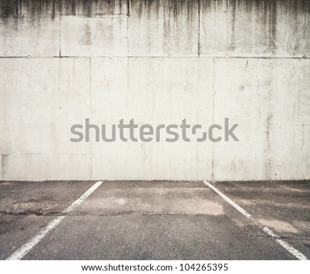 Concrete parking lot wall - stock photo
